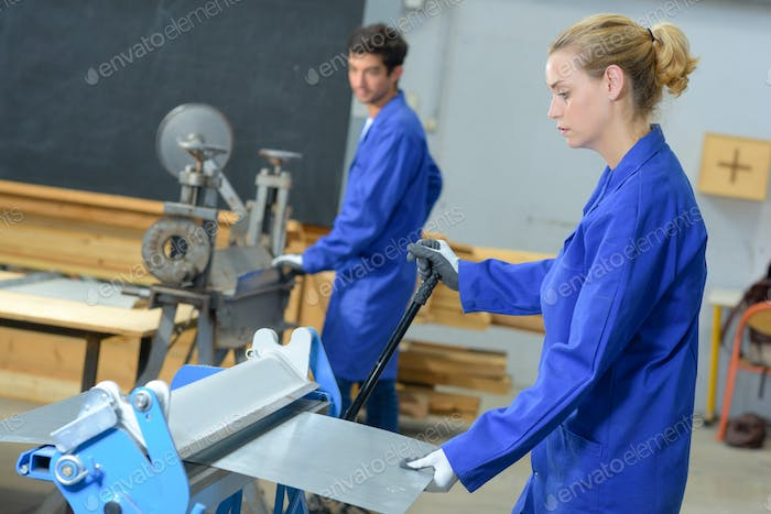 Young industrial operatives at work