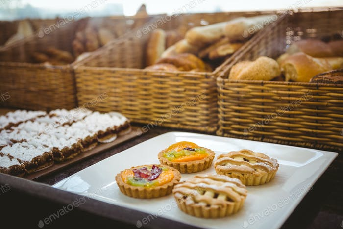 Close up of basket with fresh bread and pastry at the bakery