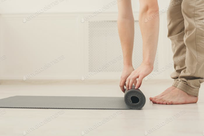 Rolling up fitness mat for exercise copy space
