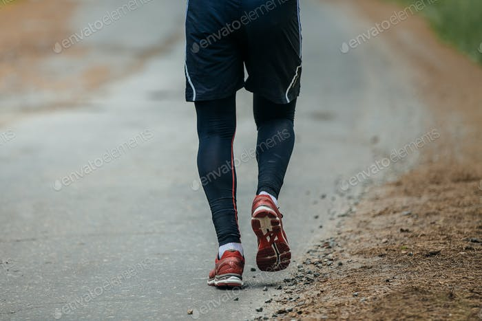 Man Running on Road in Woods