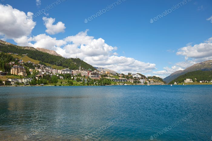 Sankt Moritz town and blue lake in a sunny day in Switzerland