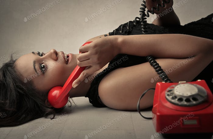 Woman talking at a vintage phone