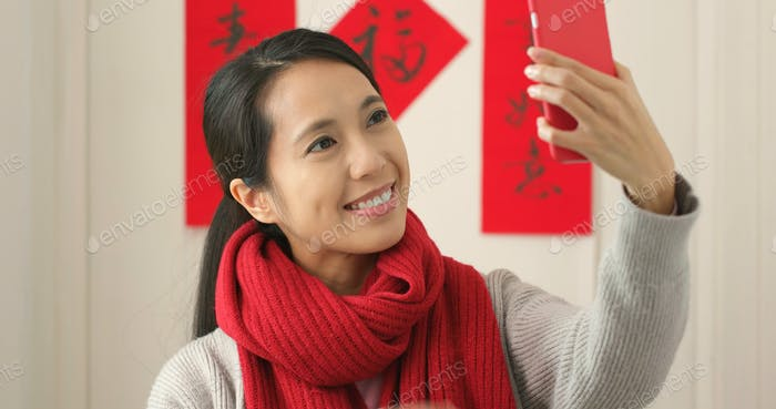 Chinese woman taking selfie in Chinese new year holiday