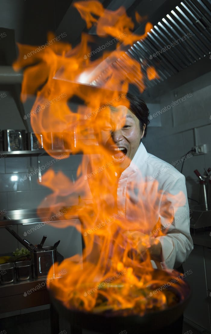 The cook making a flambe