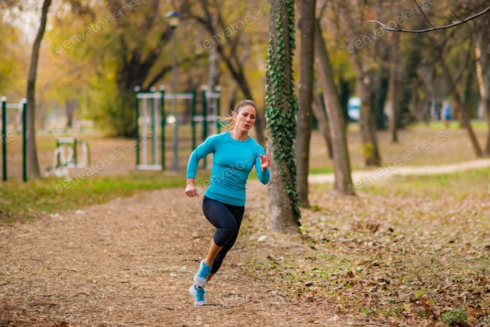Jogging Outdoors. Attractive Woman, Park, Nature