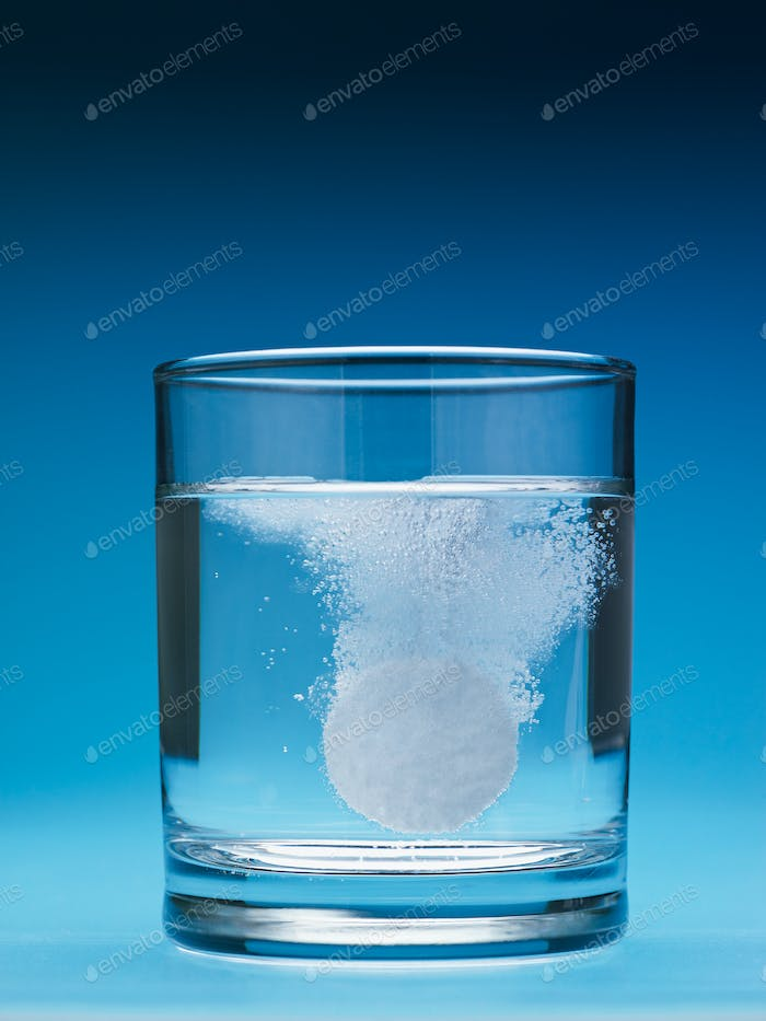 Painkiller Tablet Dissolving In Water Glass