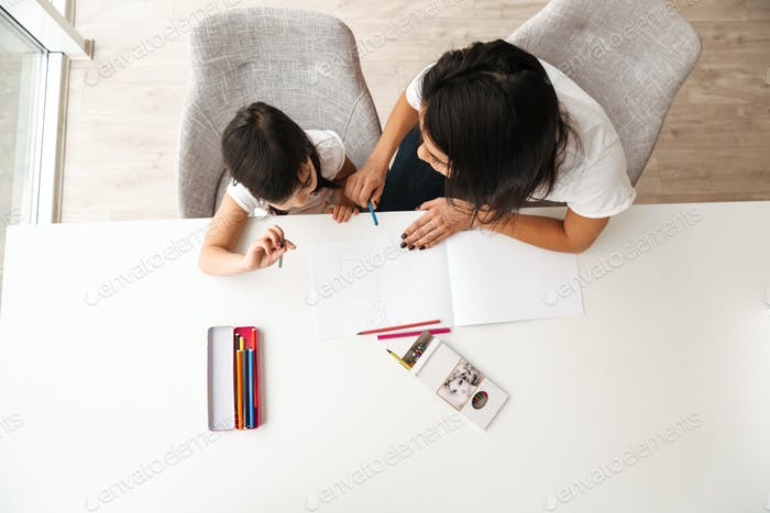 Image from above of young woman and little kid taking pleasure w