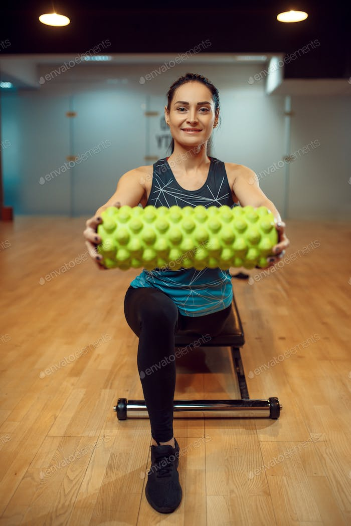 Sporty woman, pilates training with roll