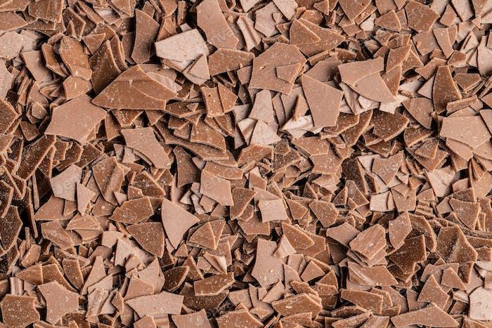 Grated dark chocolate. Chocolate flakes background.