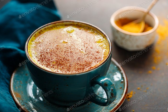 Closeup view of turmeric latte cup