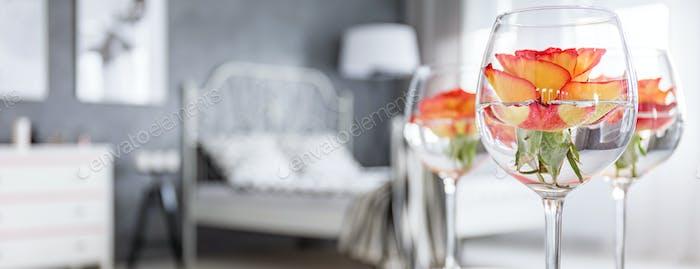 Roses in wine glasses