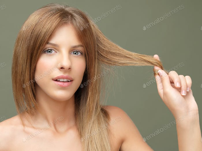 happy woman playing with her hair