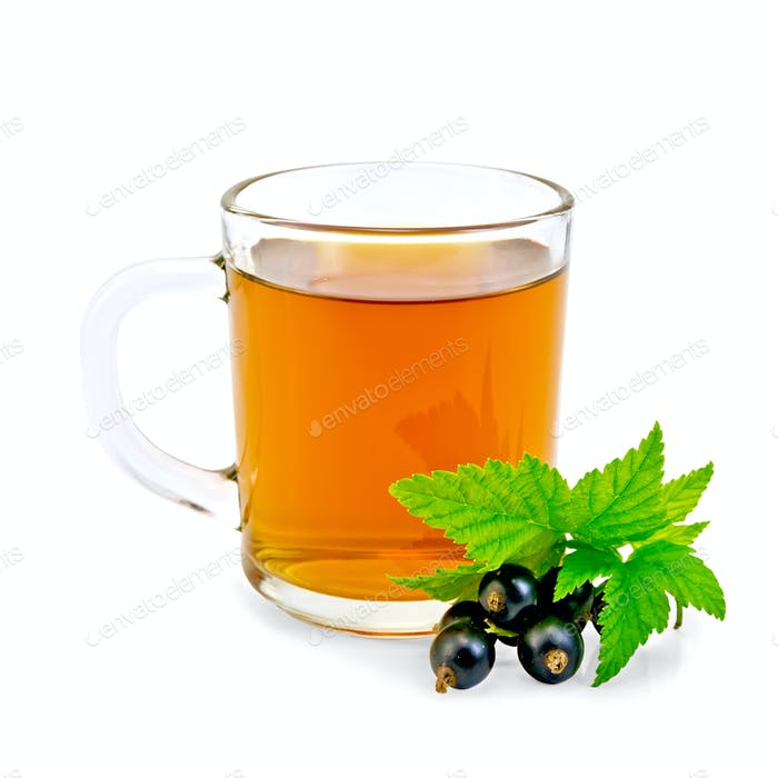 Tea with black currant in glass mug