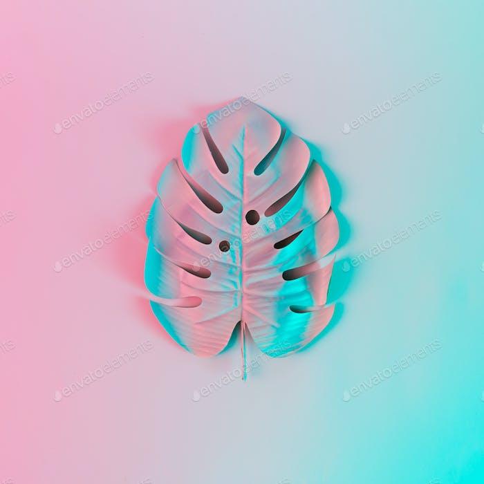 Tropical leaf in vibrant bold gradient holographic colors. Concept art. Minimal surrealism.