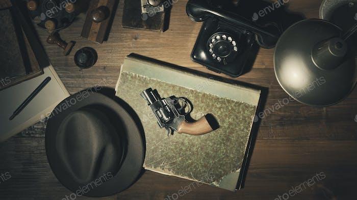Noir 1950s style detective desktop with revolver