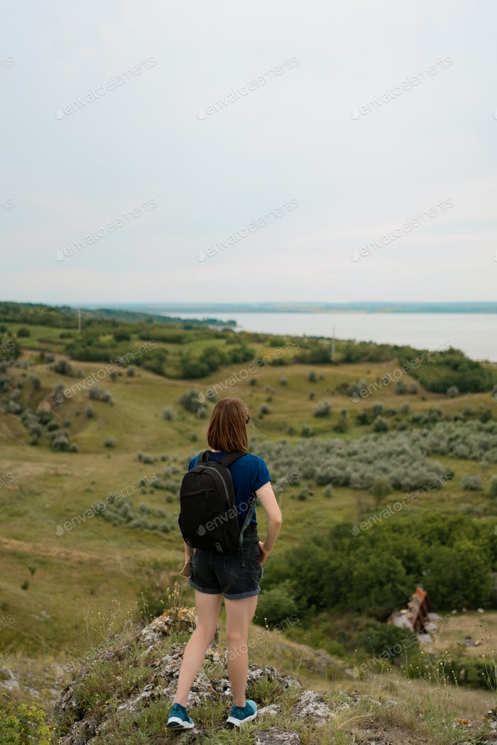 Hill walker standing in the middle of nature wilderness
