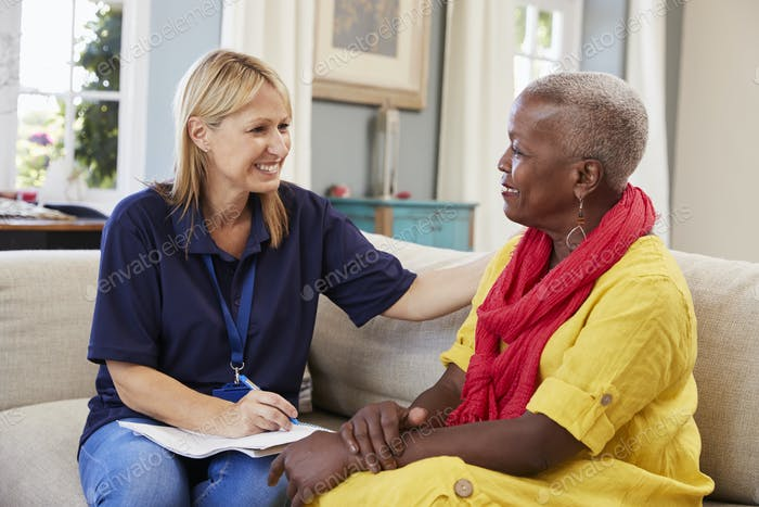 Female Support Worker Visits Senior Woman At Home