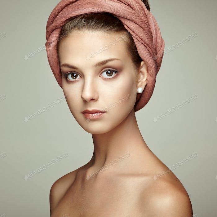 Portrait young beautiful brunette woman with elegant headdress