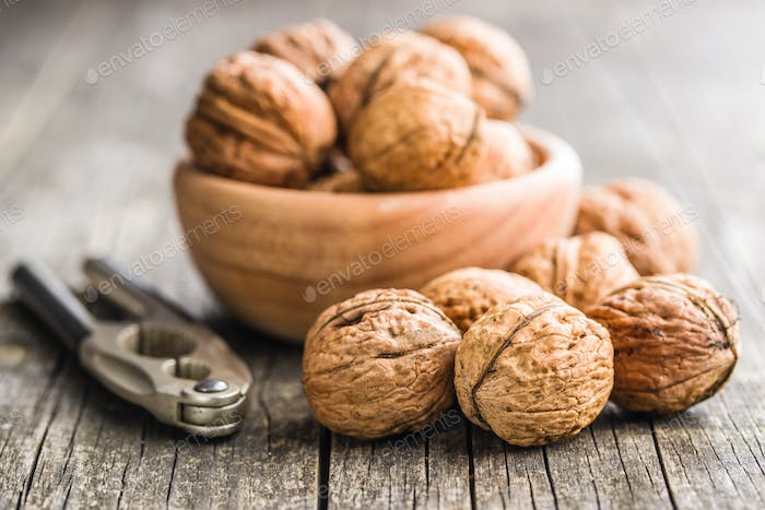 Tasty dried walnuts and nutcracker.