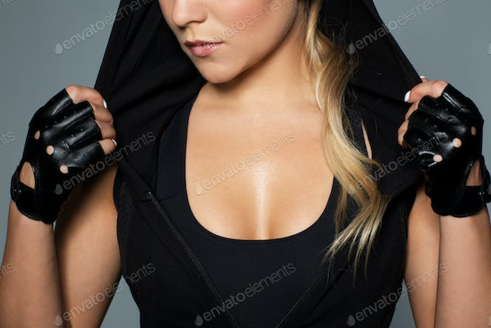 close up of woman in black sportswear
