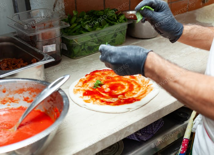 Preparation of traditional Neapolitan pizza.