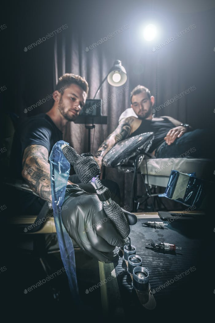 Man tattoo master