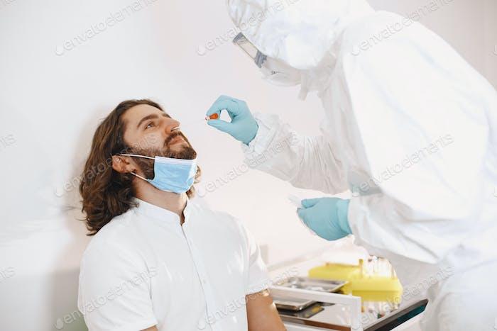 Medical worker taking a swab for corona virus