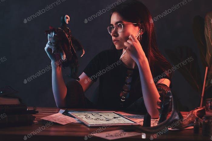 Portrait of cute designer girl at workshop