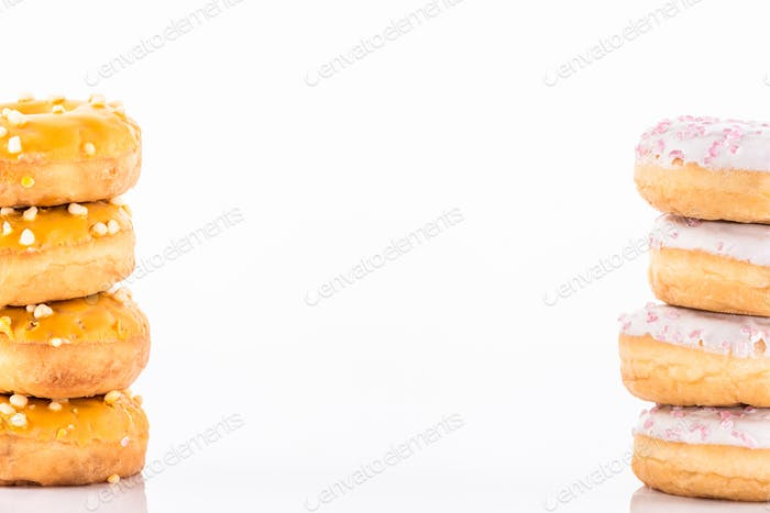 Donuts Tower Stack Pile on White Background. Food Border Background