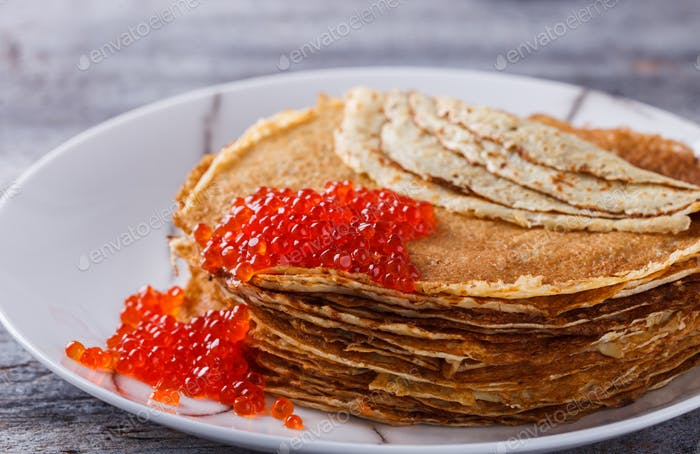 Pancakes with red caviar.