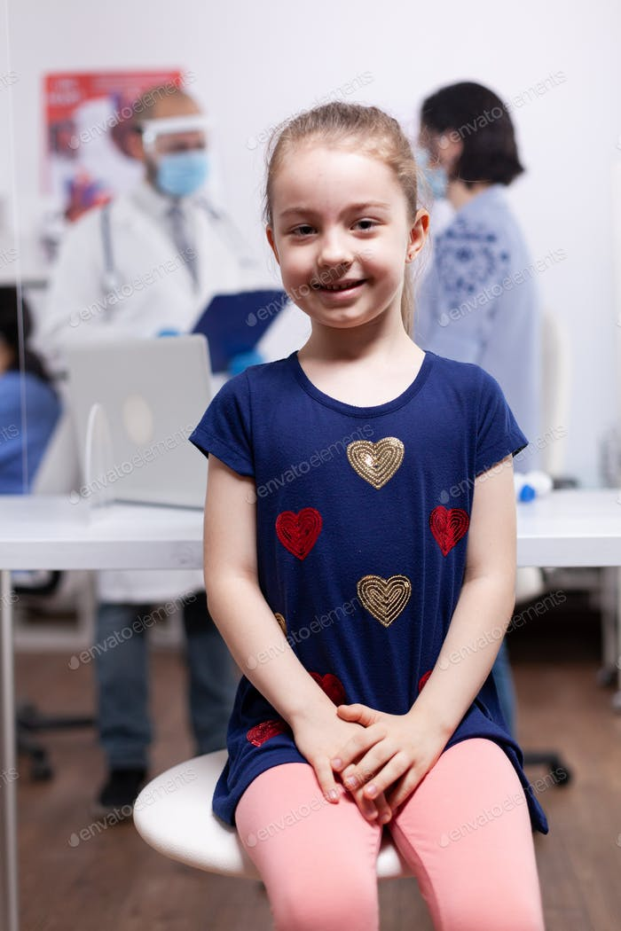 Girl at medical examination during pandemic