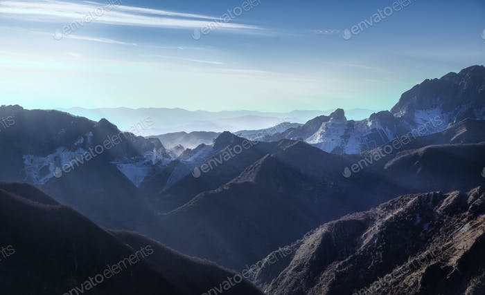 Alpi Apuane mountains and marble quarry view at sunset. Carrara,