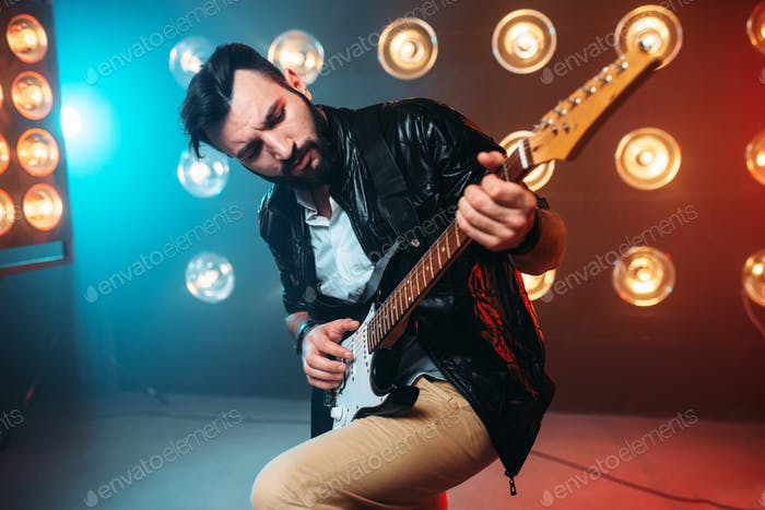 Male solo musican with electro guitar