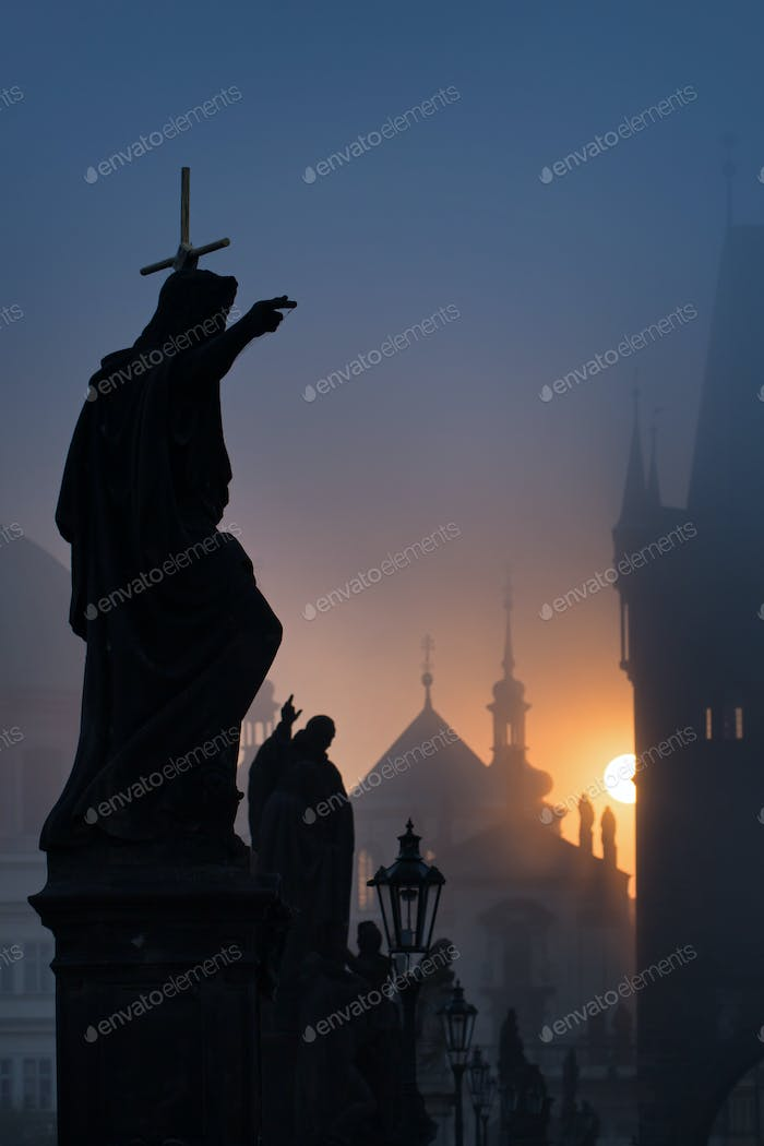 Statues of Charles Bridge at dawn