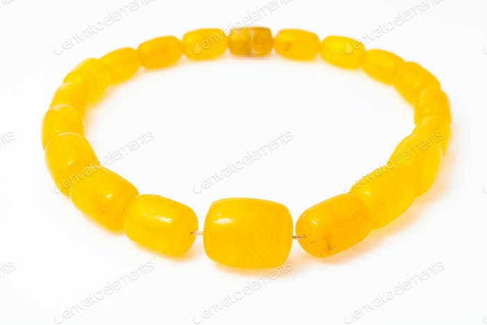 necklace from yellow melted amber on white