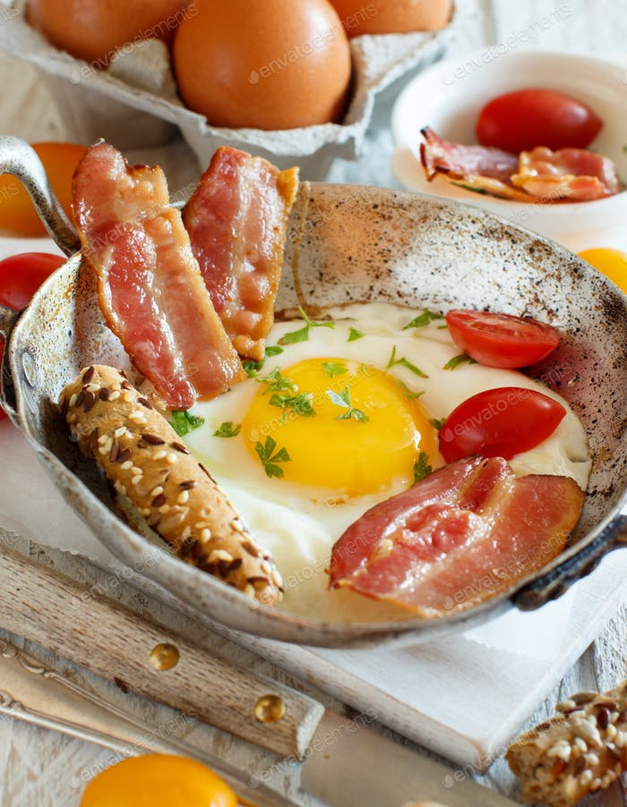 Breakfast with fried eggs and bacon - Continental breakfast