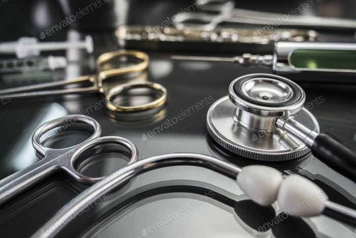 Some scissors for surgery on a tray in an operating theater, conceptual image