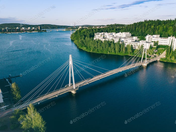 Aerial view of bridge over lake river to Campus area in Finland.