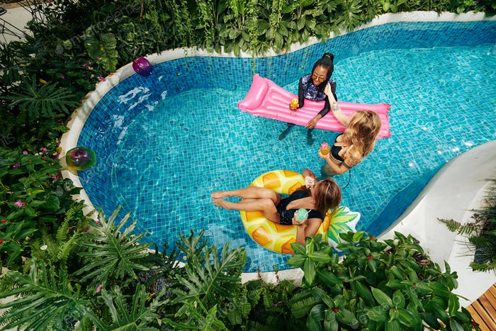 Women Relaxing in Swimming Pool