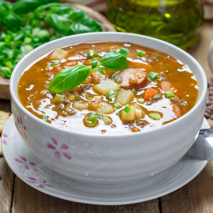 Homemade soup with lentils and sausages, square