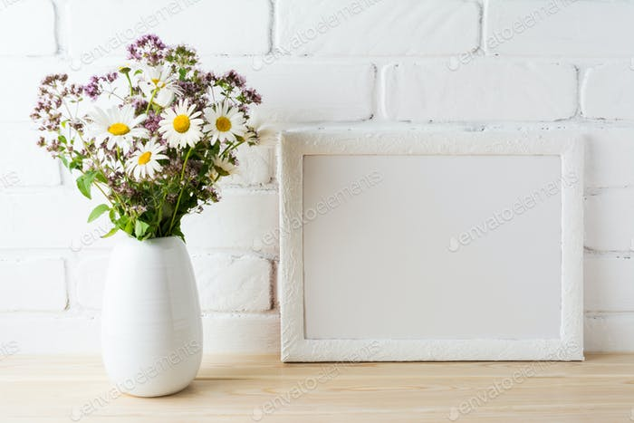 White landscape frame mockup with blooming wildflower bouquet in
