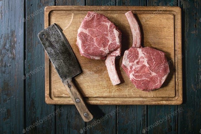Raw tomahawk steak