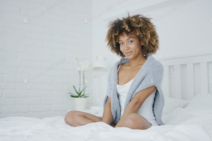 Charming model posing on bed
