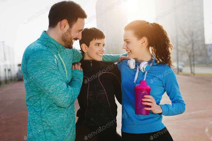 Group of healthy sporty determined friends fitness training toge