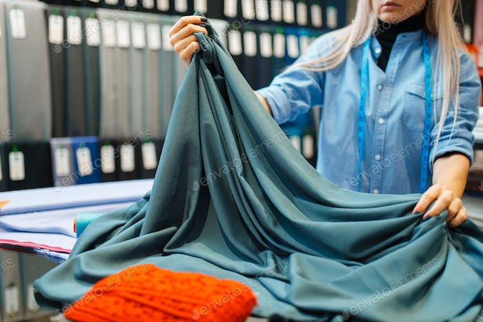 Seamstress works with fabric, textile workshop