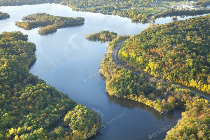 Aerial view of curving road along Mississippi River during autumn