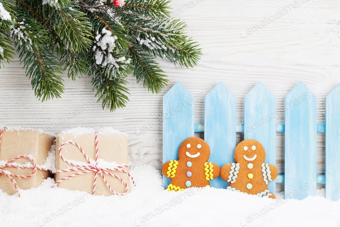 Christmas gift boxes, gingerbread cookies and fir tree