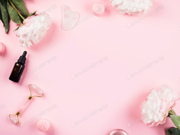 Pink beauty skin care background with flowers