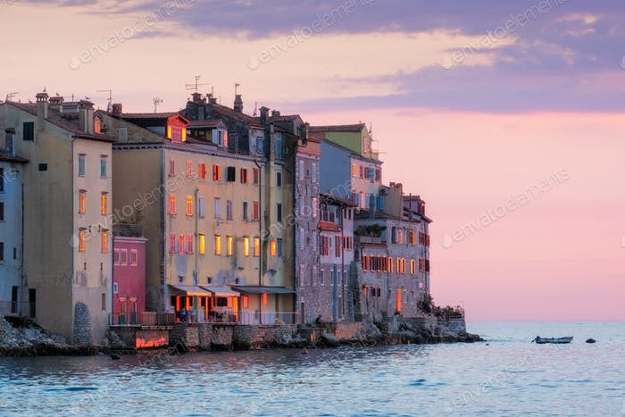 Old houses at ocean coast at colorful sunset in Rovinj, Croatia