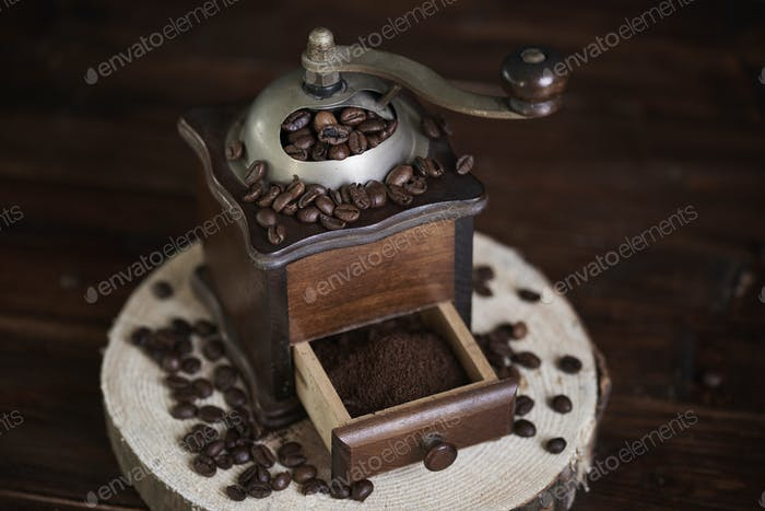 Wooden and old fashioned coffee mill